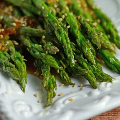 Roasted Asparagus with Apricot Sauce is an easy recipe for asparagus in the oven. The best asparagus side recipe out there! #roastedasparagus #asparagussidedishrecipe www.savoryexperiments.com