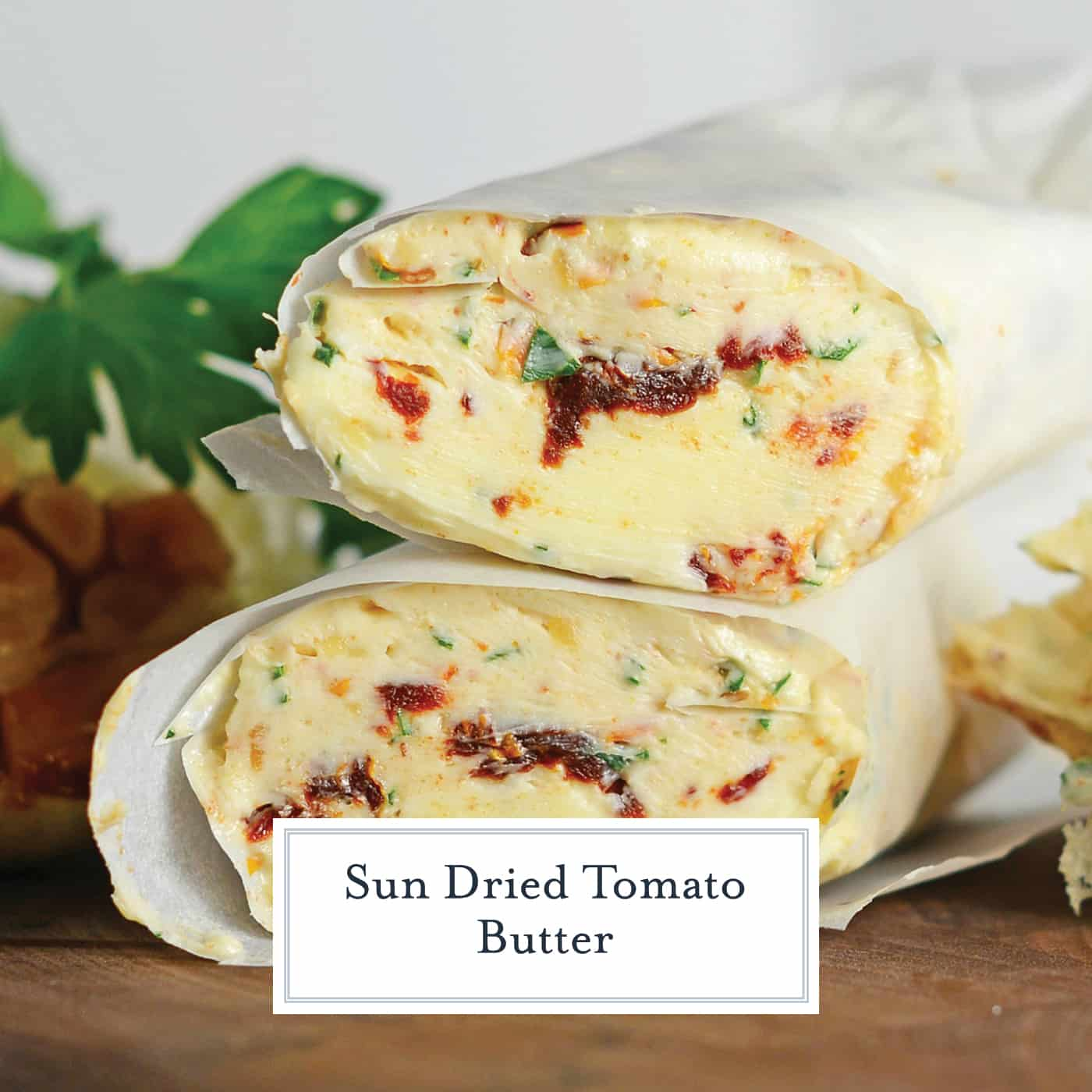 Sun Dried Tomato Butter is a flavored butter recipe made with tart sun dried tomatoes, roasted garlic and parsley. The perfect butter for Garlic Bread! #sundriedtomato #compoundbutter www.savoryexperiments.com