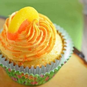 Peach cupcake in a green liner