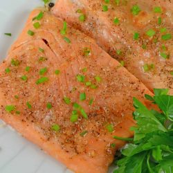 Apple Roasted Salmon is one of my favorite healthy and quick dinners. This recipe is perfect for busy families who need a tasty dinner fast! #bakedsalmon #easysalmonrecipes www.savoryexperiments.com