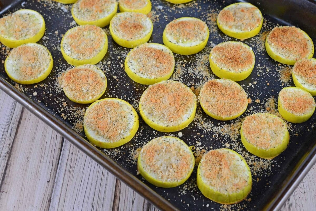 Crispy Summer Squash is a great new way to cook squash. Baked and topped with parmesan cheese and bread crumbs, it is sure to be your new favorite side dish.