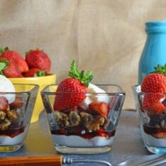 Balsamic Strawberry Parfait- Easy dessert recipe with layers of ice cream, yogurt-whipped cream mix, macerated strawberries and candied walnuts. Perfect for feeding a crowd or dinner parties! www.savoryexperiments.com