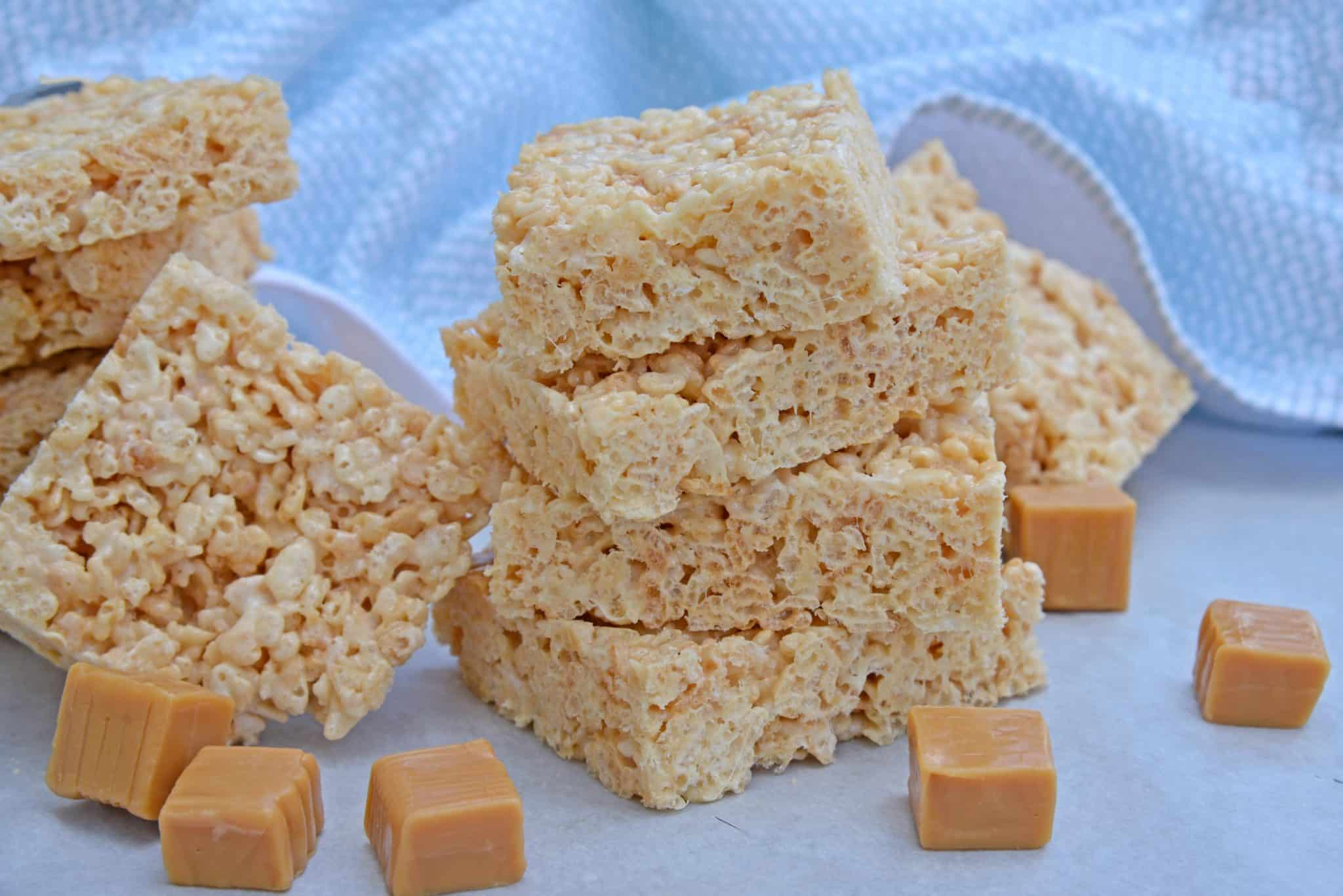 Caramel Rice Krispie Treats are a new twist on an old favorite! These homemade Rice Krispie Treats are so good and miles better then the store bought ones! #ricekrispietreats #ricekrispiebars www.savoryexperiments.com