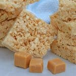Caramel Rice Krispie Treats are a new twist on an old favorite! These homemade Rice Krispie Treats are so good and miles better then the store bought ones! #homemadericekrispietreats #carameldesserts www.savoryexperiments.com