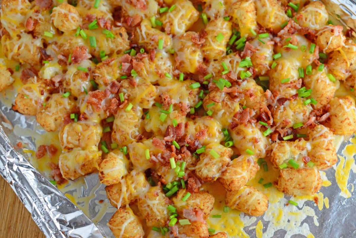 Cheesy loaded tater tots on a foil lined pan