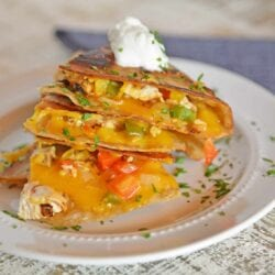 pile of chicken quesadillas with sour cream
