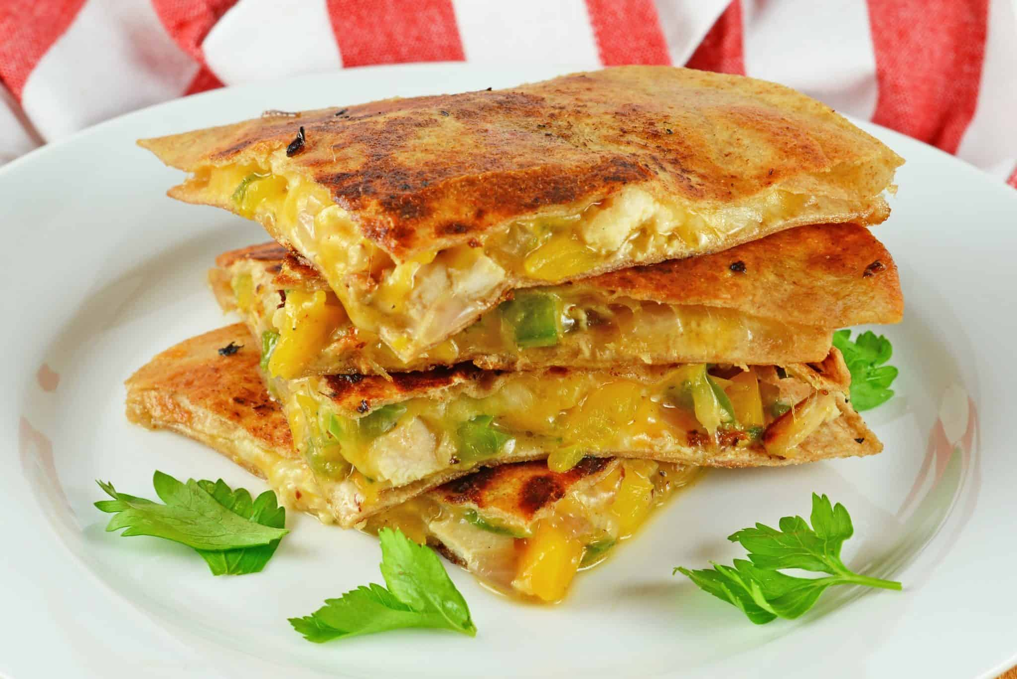 Easy chicken quesadillas recipe with crispy tortillas, chopped vegetables and lots of cheese! Come see my tips and tricks making this recipe THE BEST!