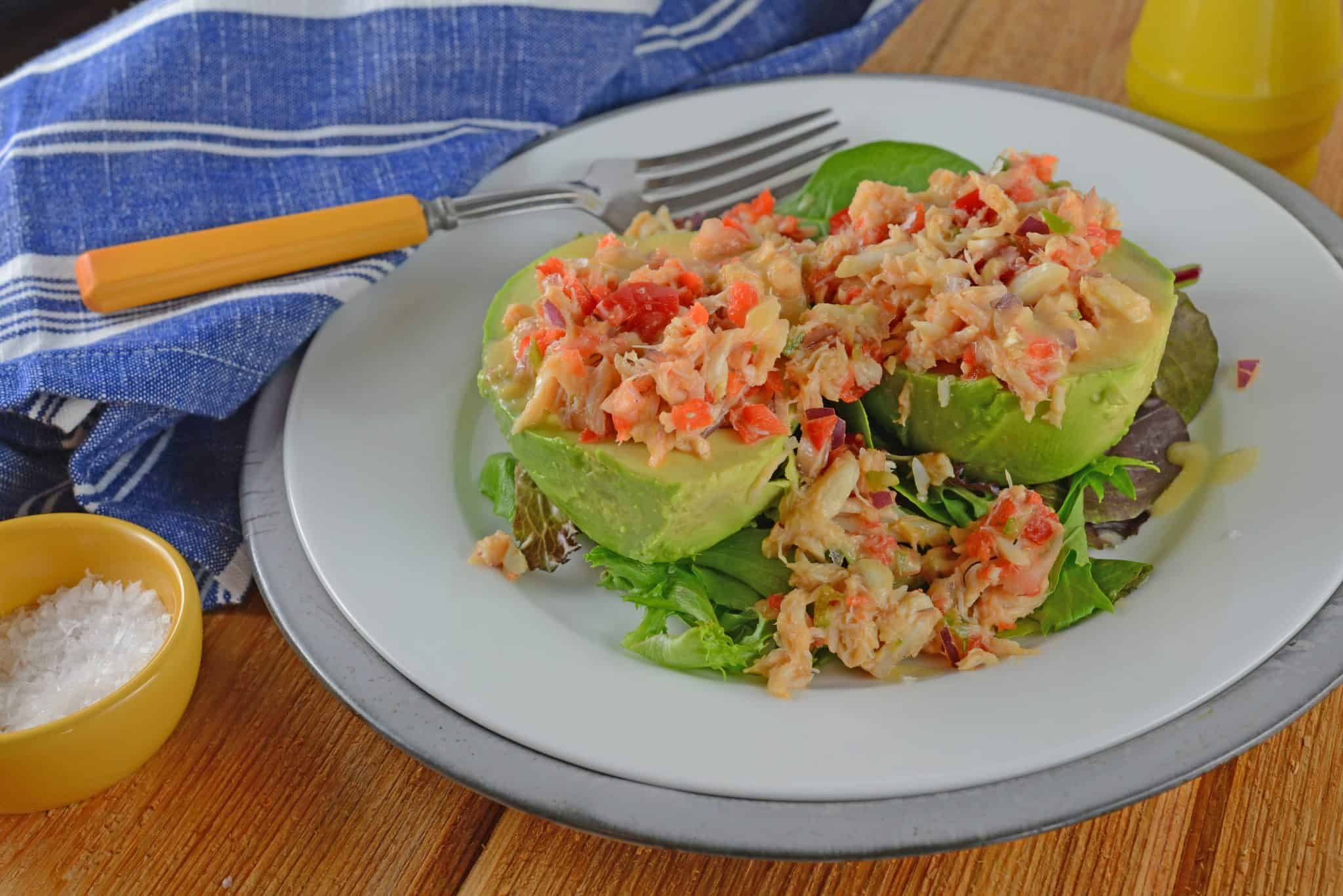 Crab and Avocado Salad is a simple and delicious salad. It combines avocado, red onion, jalapeno, bell peppers, crab, and topped off with miso dressing! #avocadosalad #recipeswithcrab #crabmeat www.savoryexperiments.com
