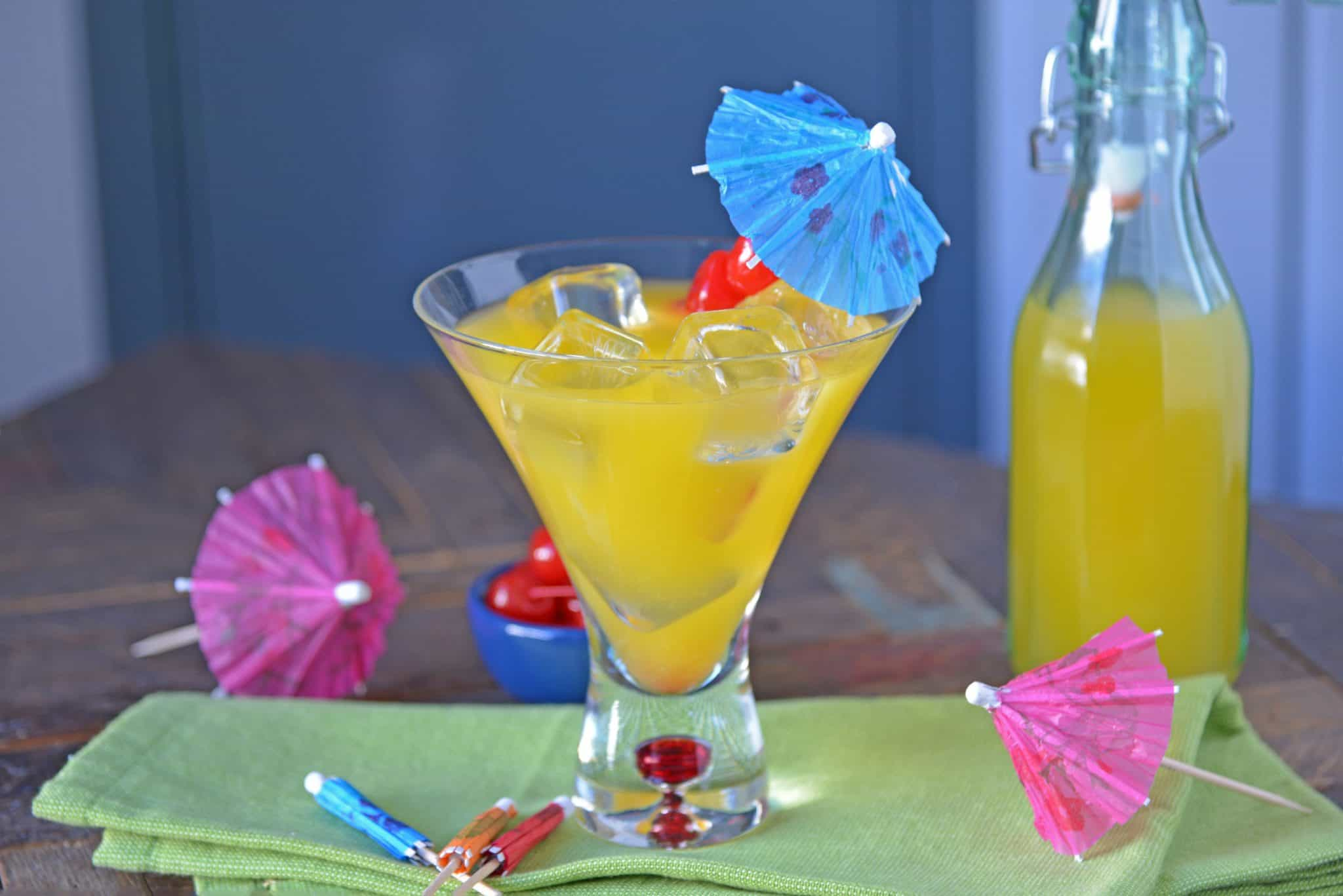 A Mango Sunrise is a deliciously refreshing tequila cocktail that is perfect for sipping any time of day! This Mango Sunrise recipe makes one delicious drink! #tequilacocktails #cocktailsthatusetequila #mangococktails