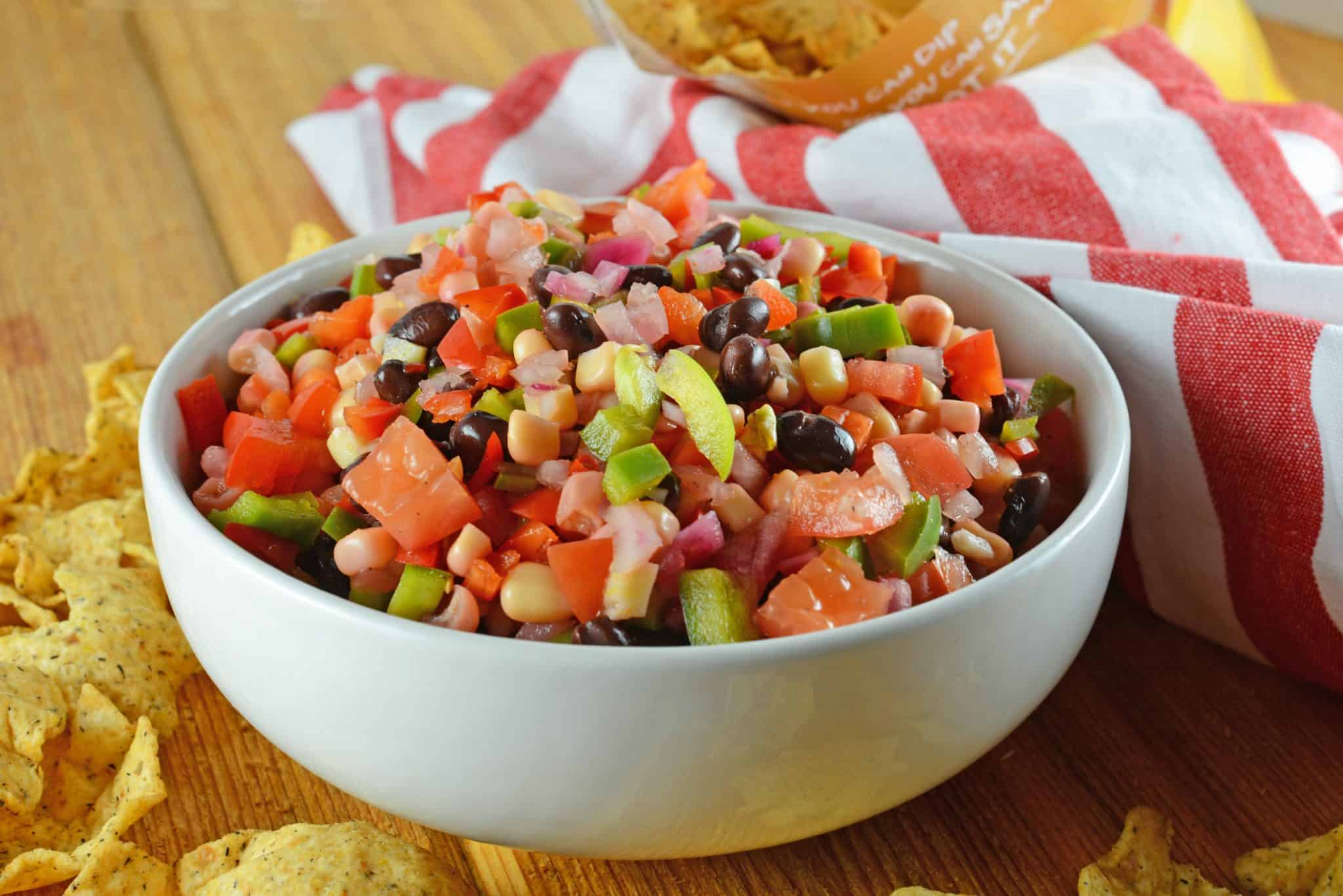 Cowboy Caviar Dip is my most popular recipe! This Texas caviar is made with fresh vegetables, black beans and a simple marinade! #cowboycaviar #texascaviar #bbqappetizer www.savoryexperiments.com