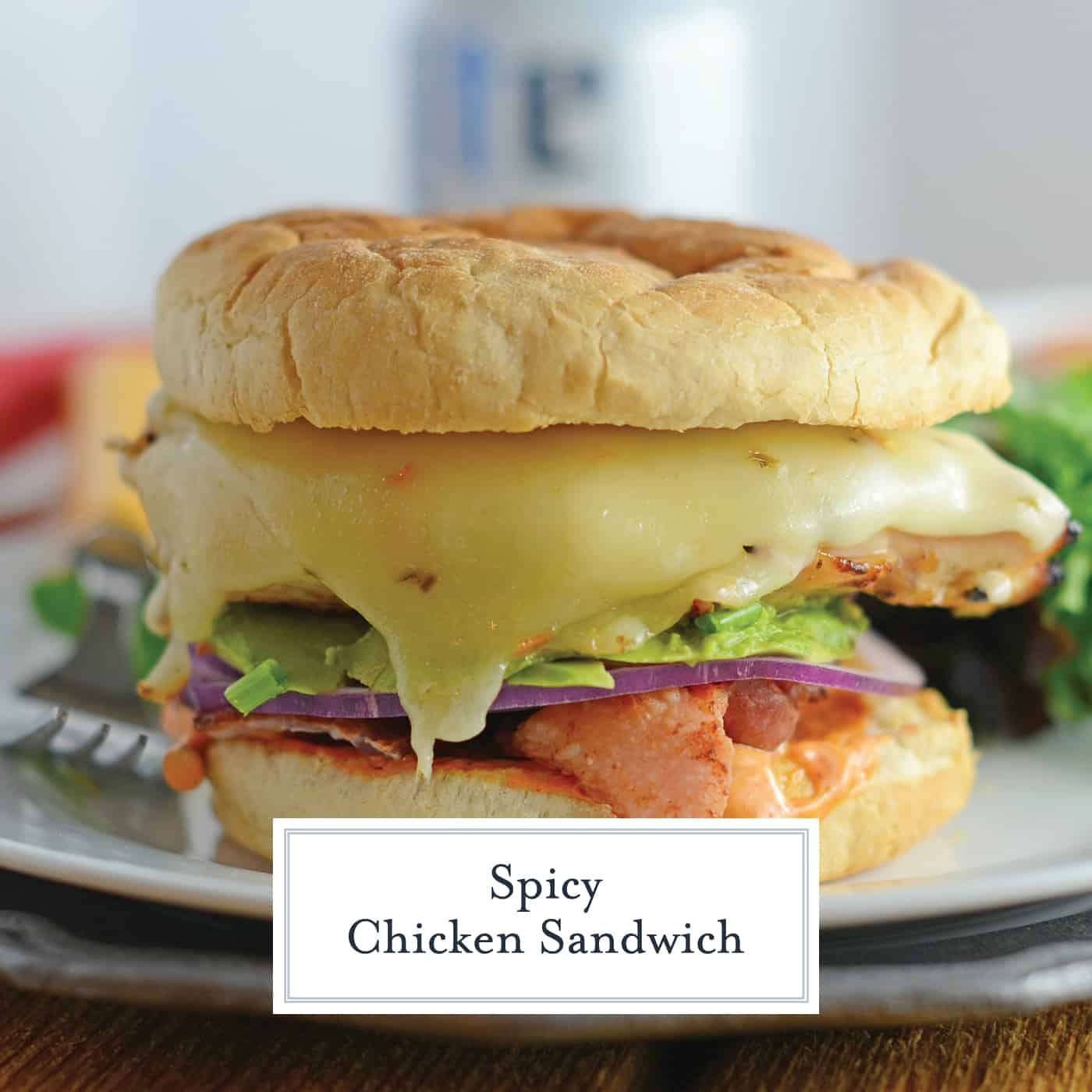 This is the best Spicy Chicken Sandwich recipe ever! It's piled high with bacon, cool avocado, spicy chipotle aioli, pepper jack cheese and crisp lettuce! #chickensandwichrecipe #grilledchickensandwich #chickenwithchipotleaioli www.savoryexperiments.com