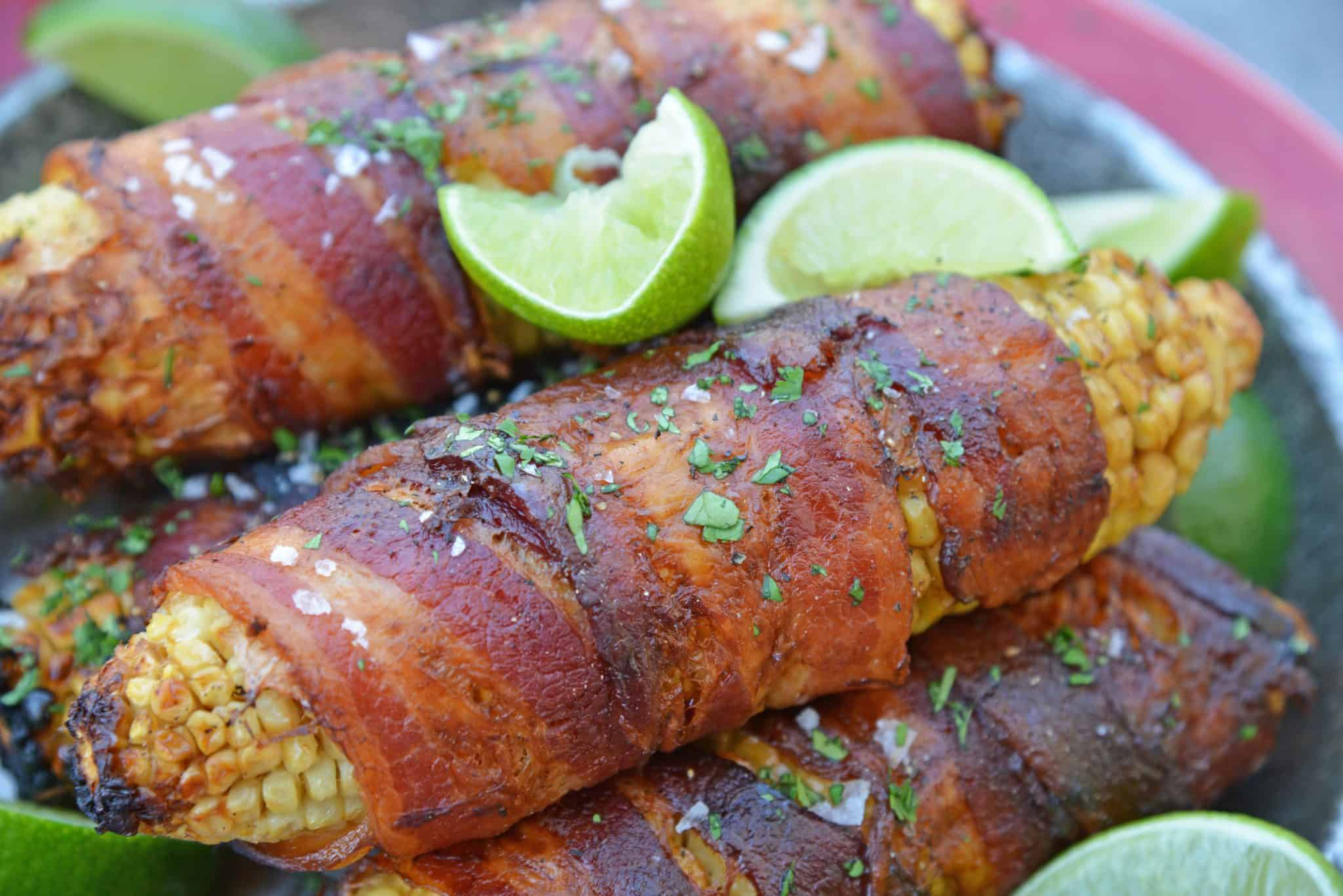 Cilantro Lime Bacon Wrapped Corn is a zesty grilled corn side dish that is perfect for any summer BBQ or Mexican fiesta! A sweet & zesty flavor combination! #grilledcorn #baconwrappedcorn #mexicancorn www.savoryexperiments.com