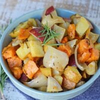 Garlic Roasted Potatoes with Rosemary are a mix of sweet and Yukon gold potatoes baked to a golden brown with olive oil, fresh rosemary, garlic and sweet onion! #ovenroastedpotatoes #garlicroastedpotatoes #potatorecipes www.savoryexperiments.com
