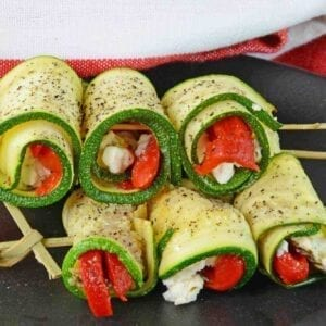 Zucchini Goat Cheese Rolls are tasty toothpick appetizers made with roasted red peppers, seasonings and creamy goat cheese. Make them ahead for an easy appetizer!