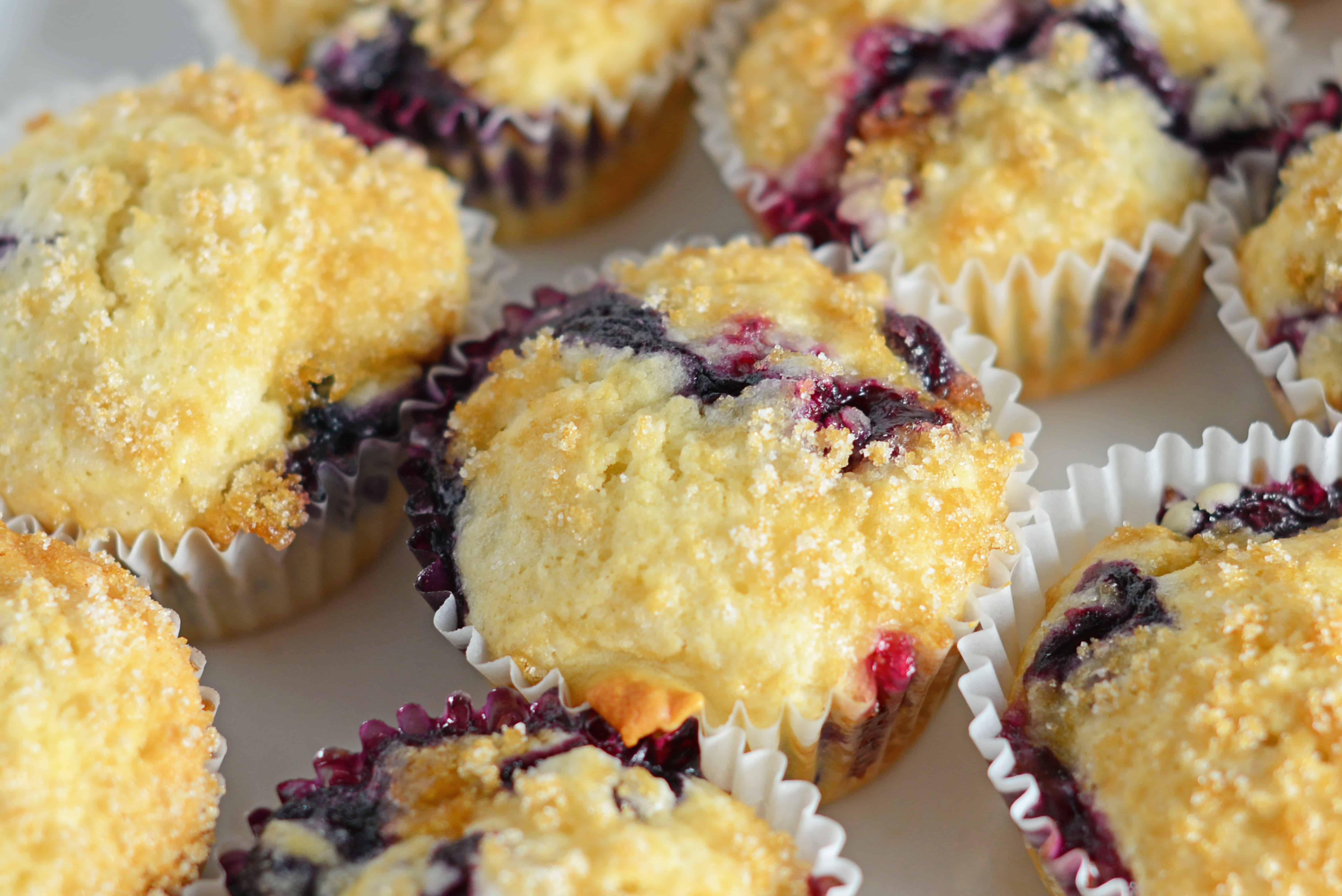 Classic Blueberry Muffins with a Streusel Crumble Topping - super easy recipe for super soft muffins. Perfect for any breakfast or brunch. www.savoryexperiments.com