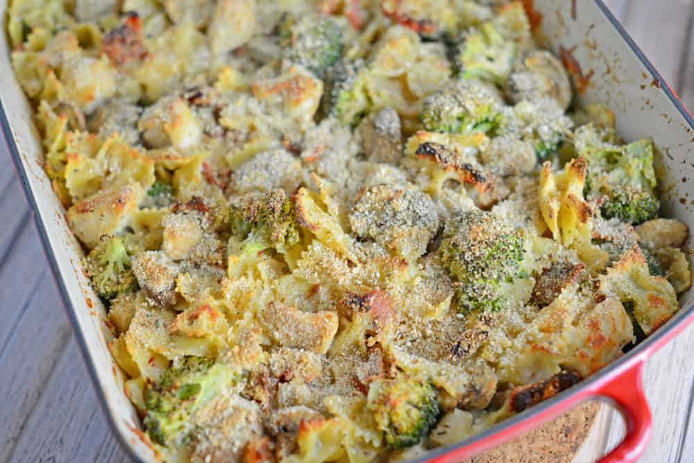 Cheesy Chicken Casserole Recipe- This easy pasta, vegetable and chicken casserole is topped with a crunchy breadcrumb crust and filled with loads of creamy cheese. This casserole recipe comes together in less than 1 hour and it takes one bowl and one casserole dish! Put this together ahead of time and pop it in the oven when you get home from work! www.savoryexperiments.com