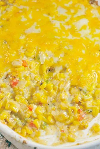 Mexican Corn Dip is a decadent and colorful appetizer recipe! A mix of corn, spices, bell peppers, jalapenos, and onion, will bring a fiesta to your table! #corndip #hotcorndip www.savoryexperiments.com