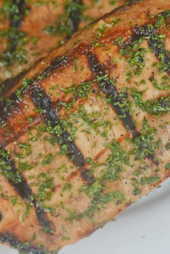 onion grilled pork chops on a plate