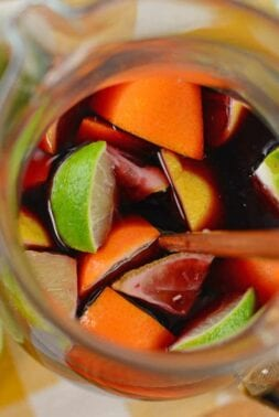 This Red Sangria recipe shows you how to make sangria the simplest way possible! It's made with sweet red wine, fresh fruit, sprite, lemonade, and fruit punch! #howtomakesangria #bestsangriarecipe #easysangriarecipe www.savoryexperiments.com