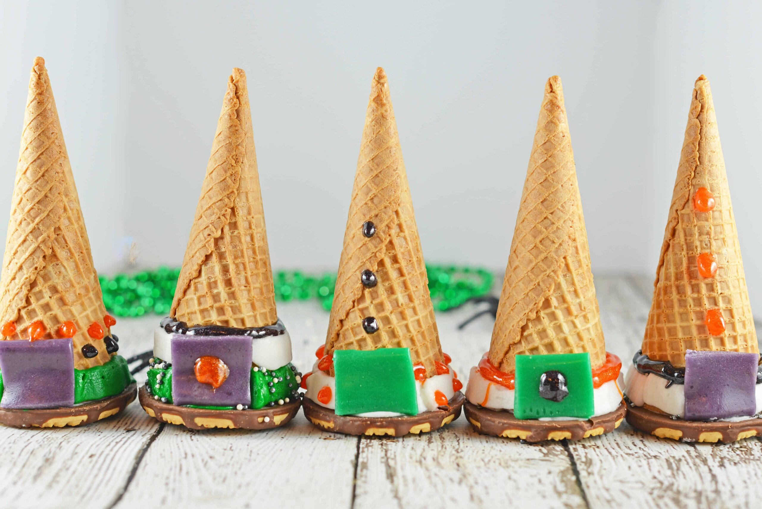 Cake Cone Witch Hats are the perfect Halloween activity for kids! Bake cake into a waffle cone, cap it with a cookie and let them decorate their own treat!