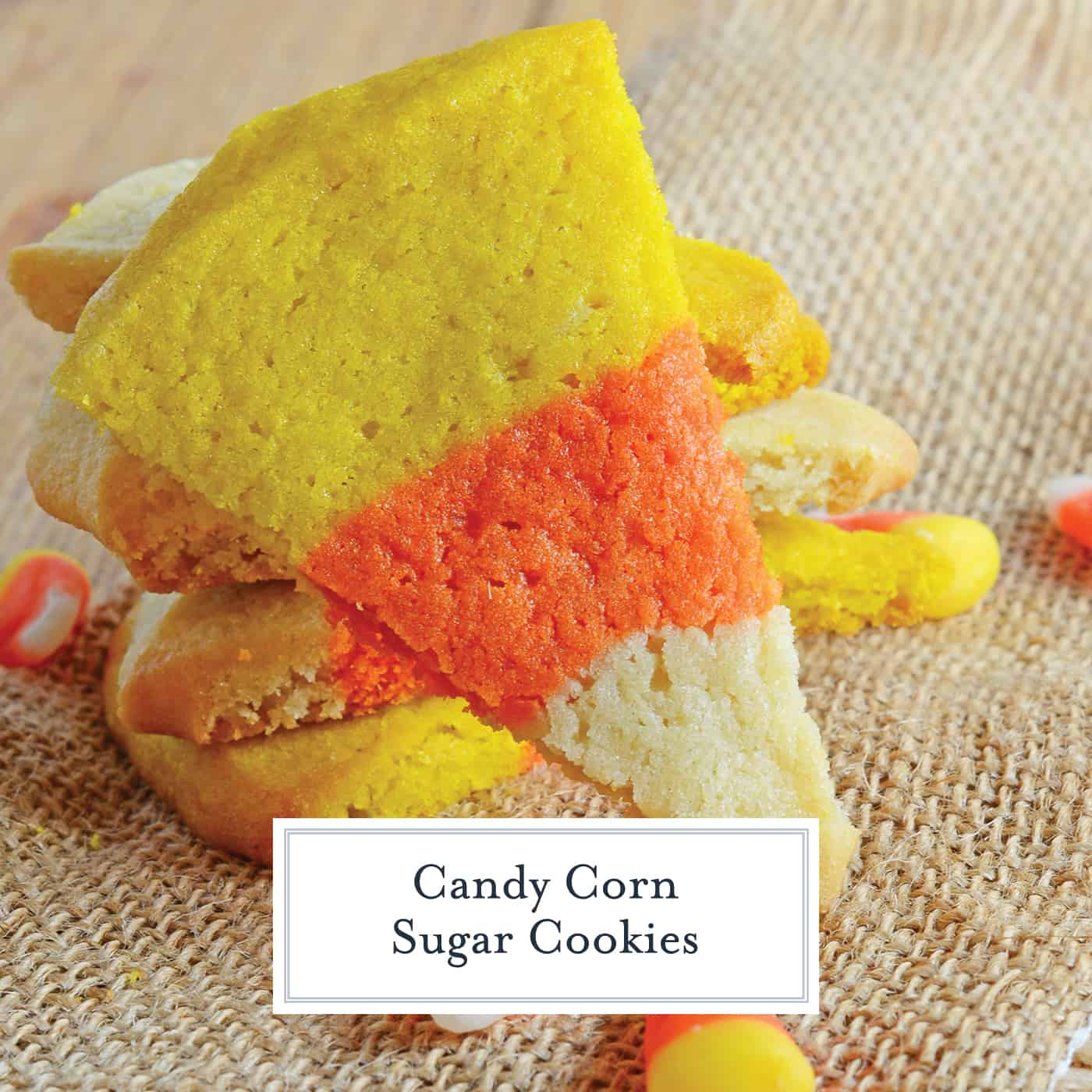 Candy Corn Sugar Cookies are the perfect Halloween Cookie! These festive and easy to make Halloween treats are perfect for any costume party! #halloweencookies #halloweendesserts #halloweensugarcookies www.savoryexperiments.com