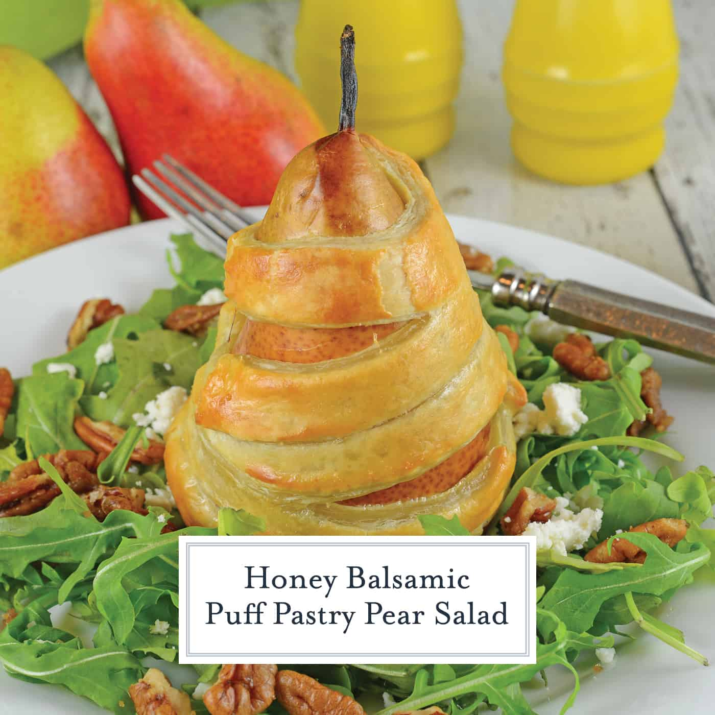 Pear Salad with Candied Walnuts, Honey Balsamic Dressing and tart goat cheese makes the perfect winter salad for dinner parties and holidays. #pearsalad #pearrecipes #bakedpears www.savoryexperiments.com