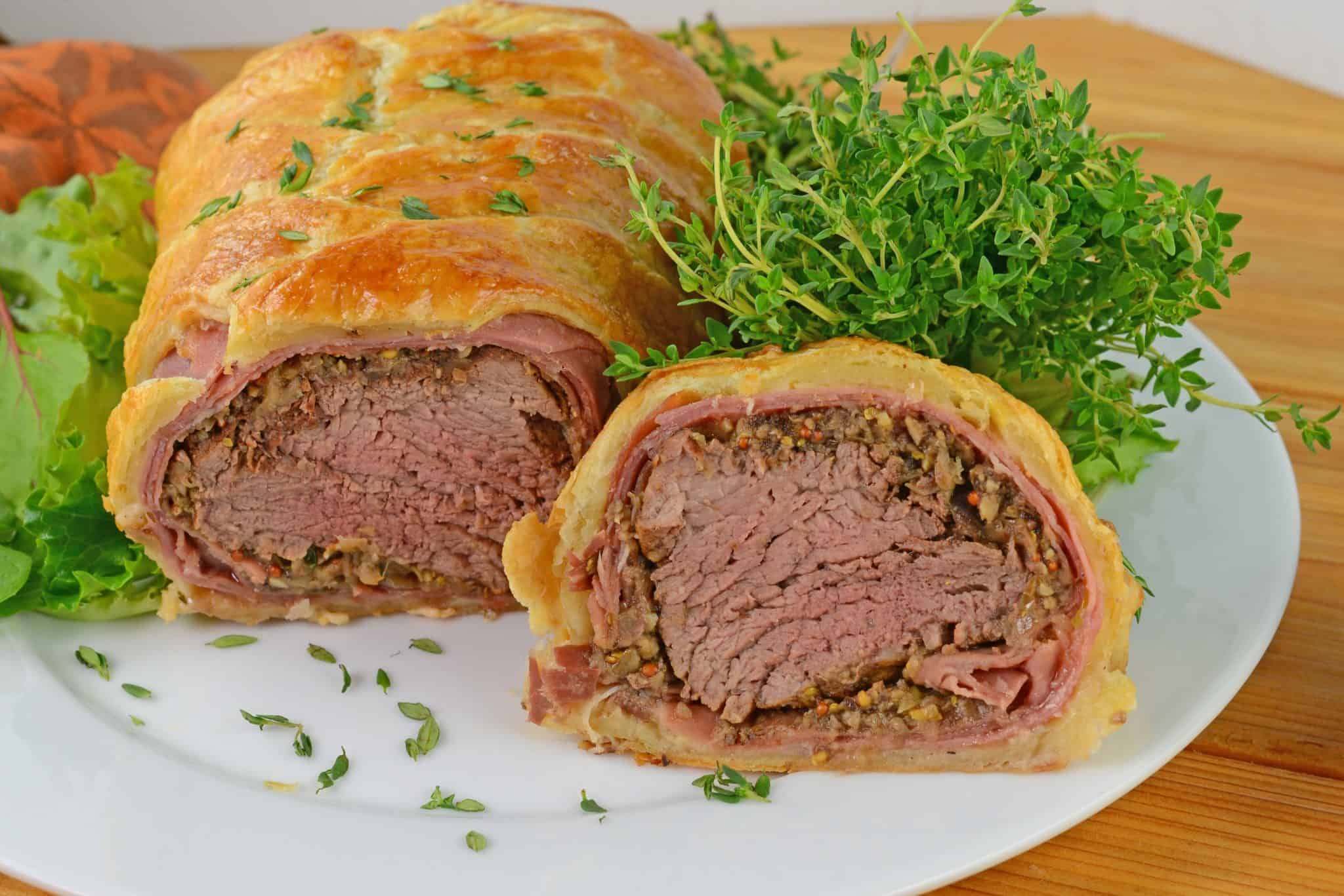 Beef Wellington a classic dish for a special occasion. Tender beef tenderloin is smothered in Dijon mustard, mushroom, shallot and proscuitto before being baked in a delicate puff pastry.