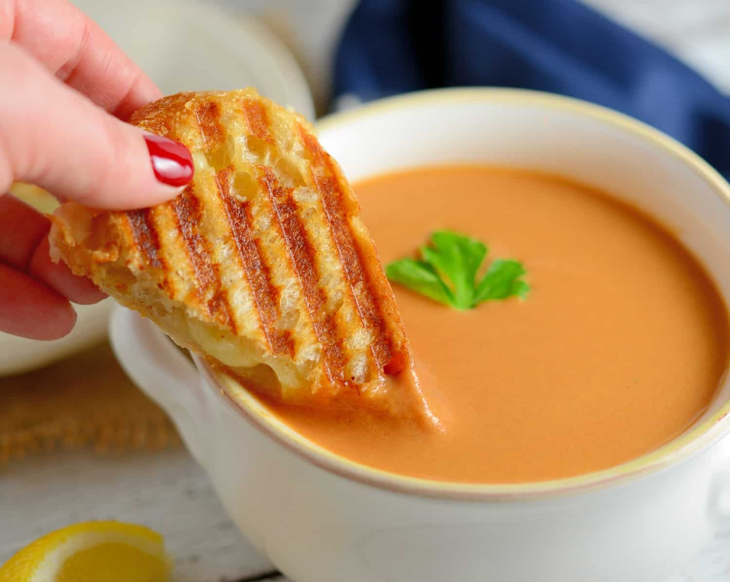 Creamy Tomato Soup - Rich and creamy, full of flavor from roasted onions, tomatoes and garlic! Make-ahead and freezer friendly!