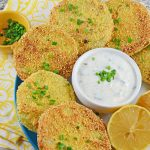Fried Green Tomatoes are a Southern tradition. Juicy tomatoes coated with cornmeal and fried to a golden brown. Lemon Herb Aioli is a new refreshing twist.