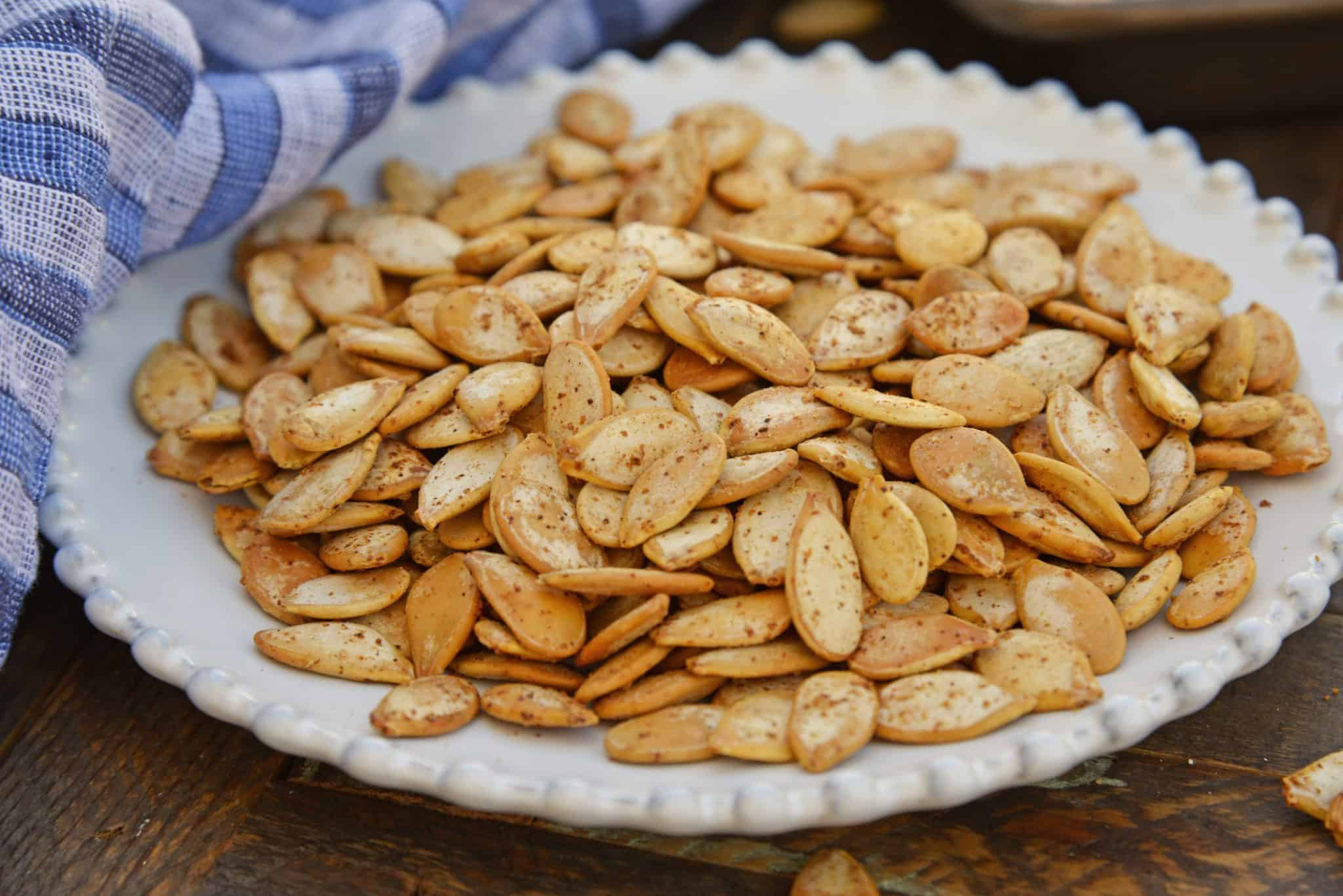 These Roasted Pumpkin Seeds are the perfect fall snack, or topping to add to salads or pasta! Pumpkin Seeds benefits are that they are healthy and nutritious! #pumpkinseedbenefits #roastedpumpkinseeds www.savoryexperiments.com