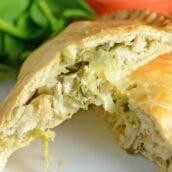 Artichoke Chicken Pot Pie is an easy hand pie recipe stuffed with shredded chicken, artichokes, spinach, red onion, cheese and zesty Italian dressing. #chickenpotpie #handpies www.savoryexperiments.com