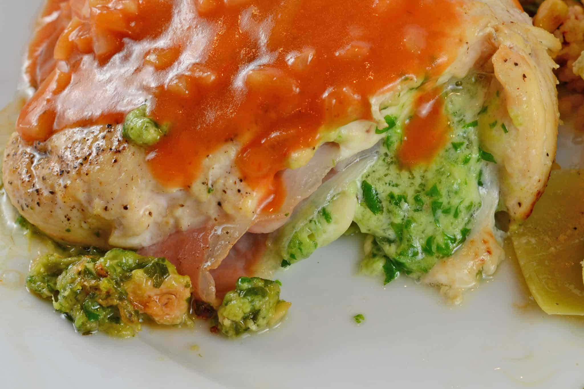 Gruyere and Prosciutto Stuffed Chicken is topped off with a silky tomato and shallot sauce. While this looks like a restaurant caliber meal, it only takes about 1 hour!
