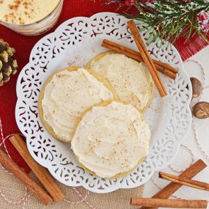 frosted eggnog cookies on a plate