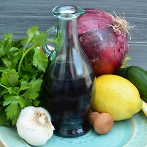 This Easy Garlic Balsamic Vinaigrette is a staple dressing to have in your home. It's so simple to make and full of tangy but savory flavors! #balsamicvinaigrette #balsamicvinegardressing www.savoryexperiments.com