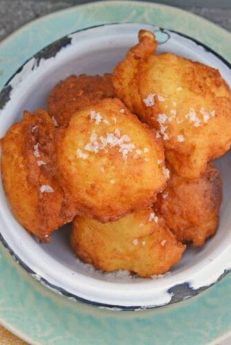 Lemon Ricotta Fritters are a savory fritter recipe. Smooth and and rich, they are filled with cheese with subtle lemon and sage. Served with garlic aioli!