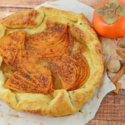 A Persimmon Tart is an easy dessert or breakfast recipe using bright orange persimmon, brown sugar and buttery puff pastry.