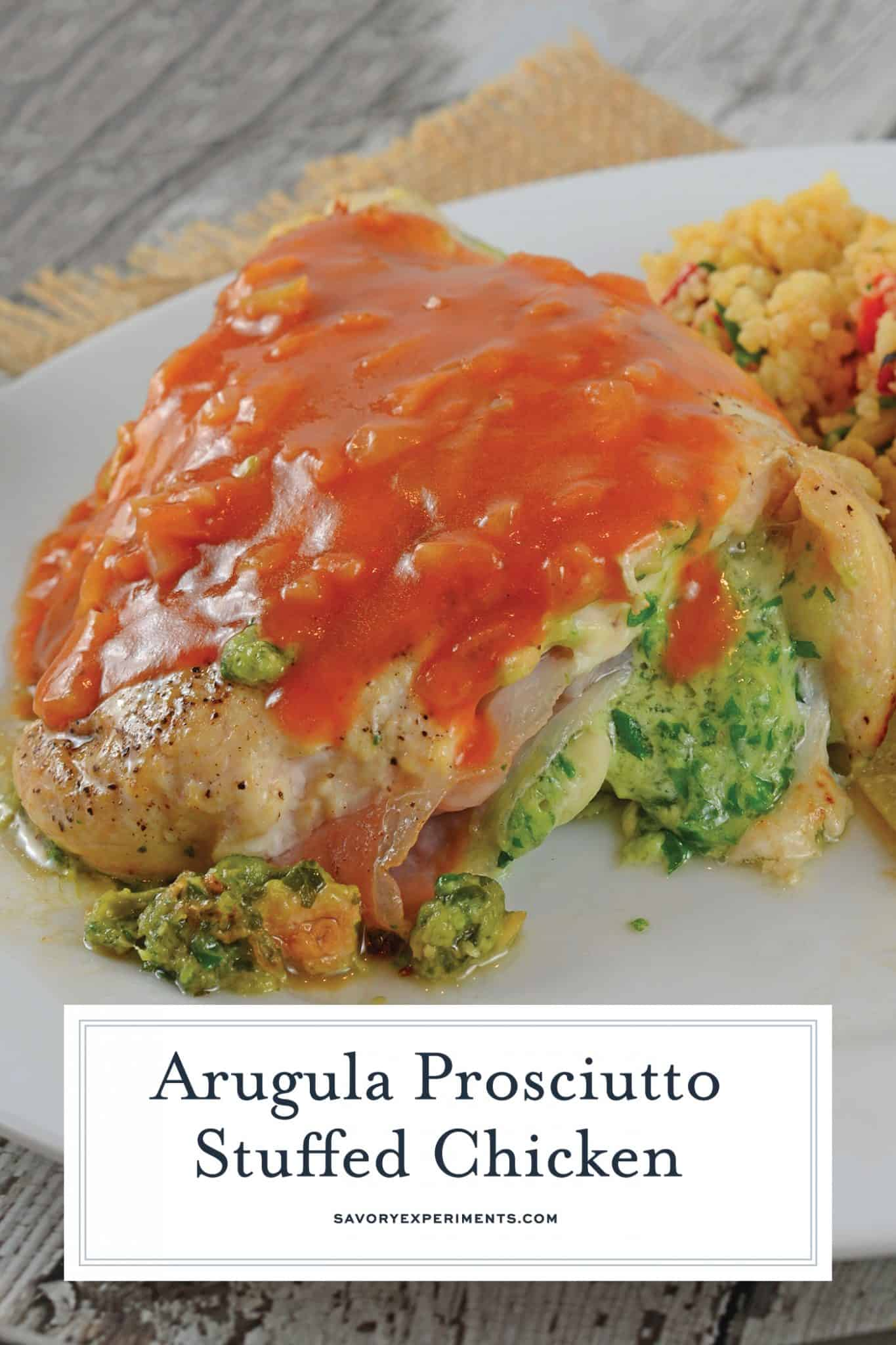 Arugula Prosciutto Stuffed Chicken is topped off with a silky tomato shallot sauce. Baked chicken recipes are great, but cheese stuffed chicken breasts are even better! #cheesestuffedchickenbreast #bakedchickenrecipe #stuffedchickenbreastrecipe www.savoryexperiments.com