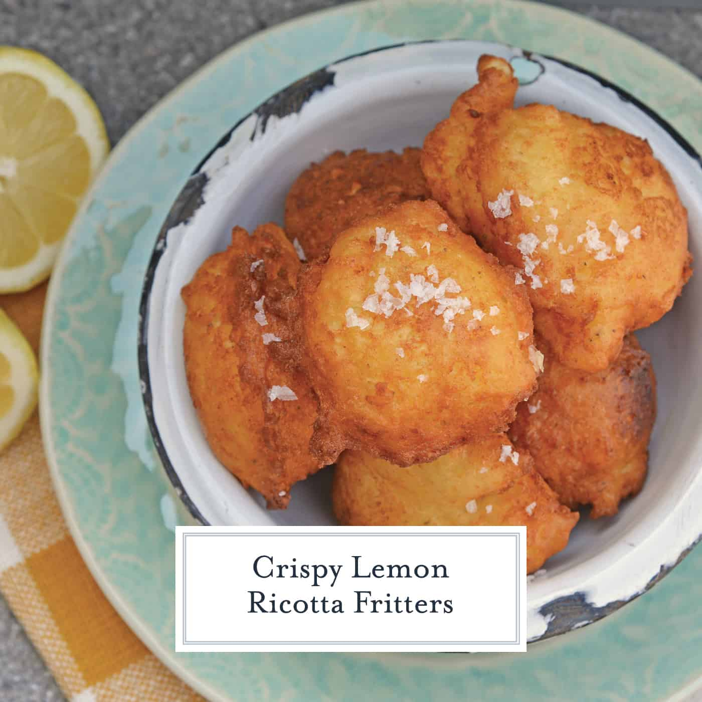 Lemon Ricotta Fritters are a savory fritter recipe. Smooth and rich, they are filled with cheese and a subtle lemon and sage. Served with garlic aioli! #frittersrecipe #ricottafritter www.savoryexperiments.com