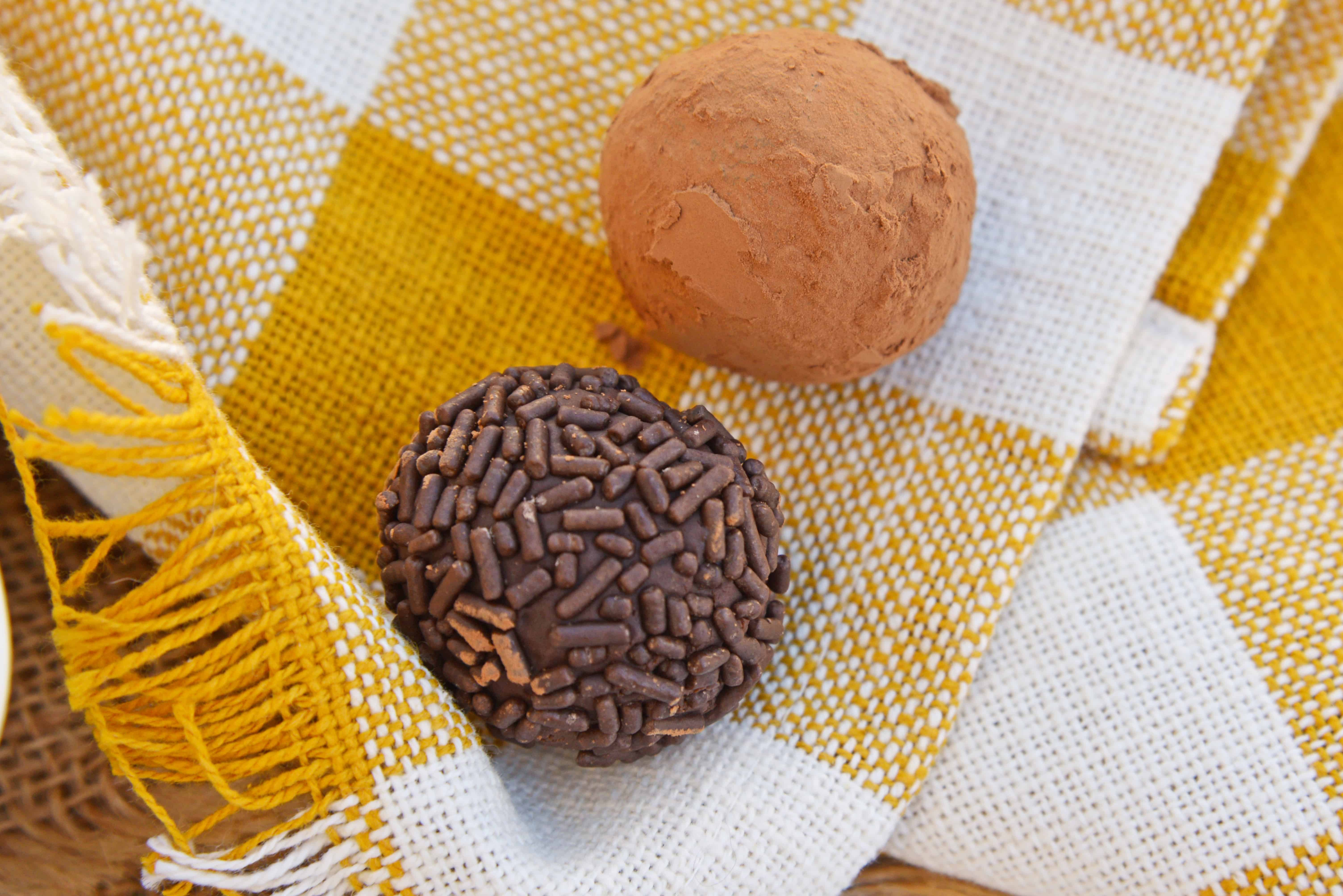 Easy Chocolate Truffles only use 4 ingredients, including sweetened condensed milk, to make a rich, decadent dessert. Roll them in chocolate sprinkles, powdered sugar or cocoa for the the finished touch! #chocolatetruffles #easytruffles www.savoryexperiments.com