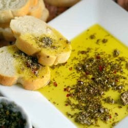 Close up of Copycat Carrabba's Olive Oil Bread Dip on a white plate