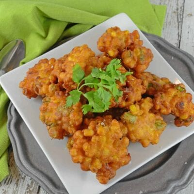 Crispy Corn Fritters are lightly fried with scallions, cumin and white pepper. Can be served as an appetizer, snack or with your favorite chili recipe.