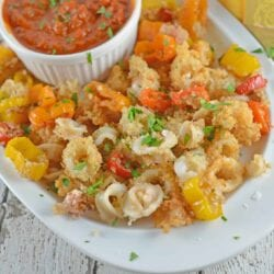 Delicious Fried Calamari are crispy squid fried to golden brown perfection. Battered Calamari is easy to make at home with a yummy calamari sauce!