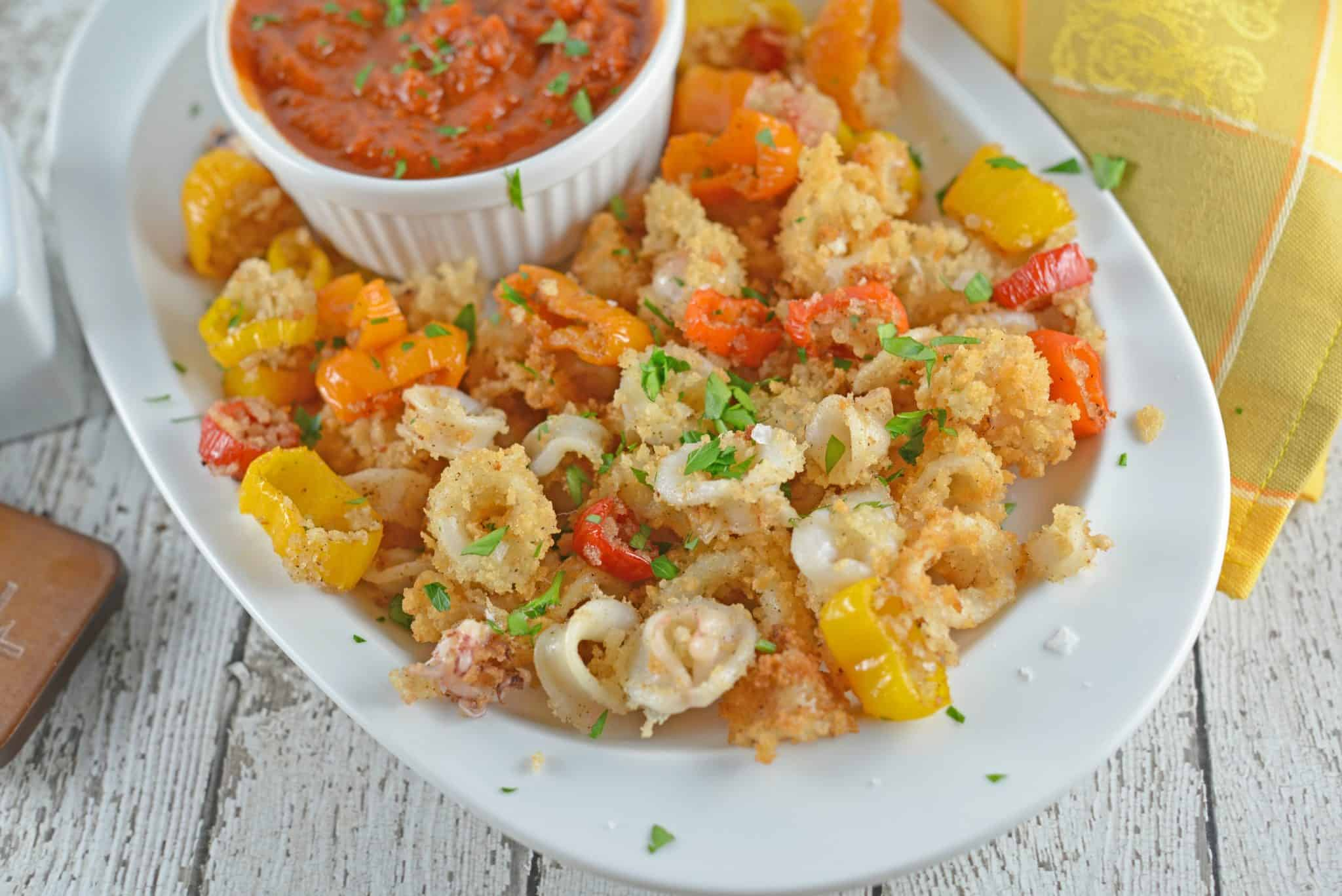 Fried Calamari are crispy squid fried to golden brown perfection. Battered Calamari is easy to make at home with a yummy calamari sauce!