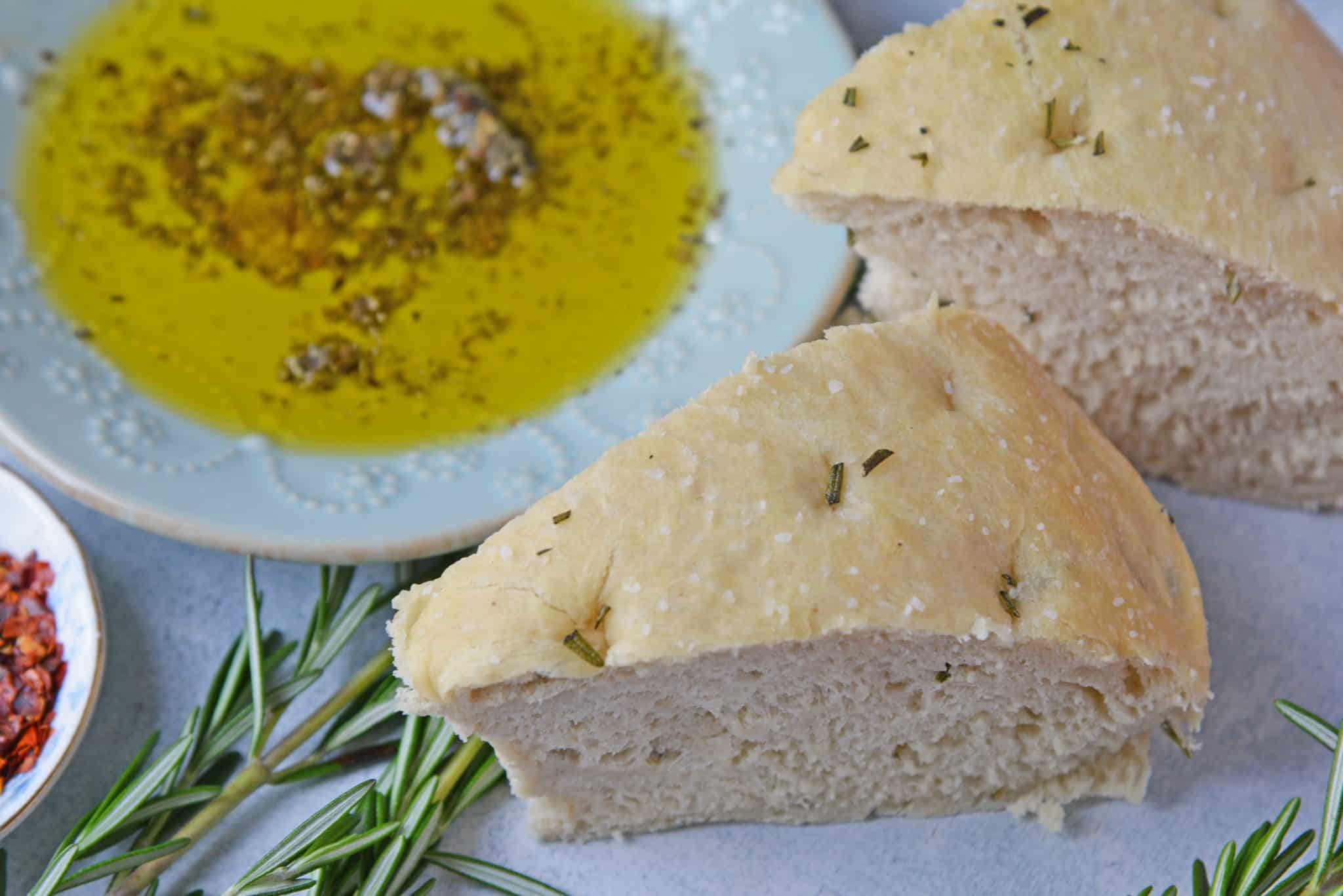 Rosemary Focaccia Bread is a recipe you can be proud of! Pair with homemade butter or olive oil bread dip for the best appetizer.  #focacciabread #easybreadrecipes www.savoryexperiments.com