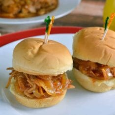 Slow Cooker Pineapple Pulled Pork Recipe- pineapple, pork and a simple BBQ sauce takes 10 minutes to put together for a tasty and quick meal.
