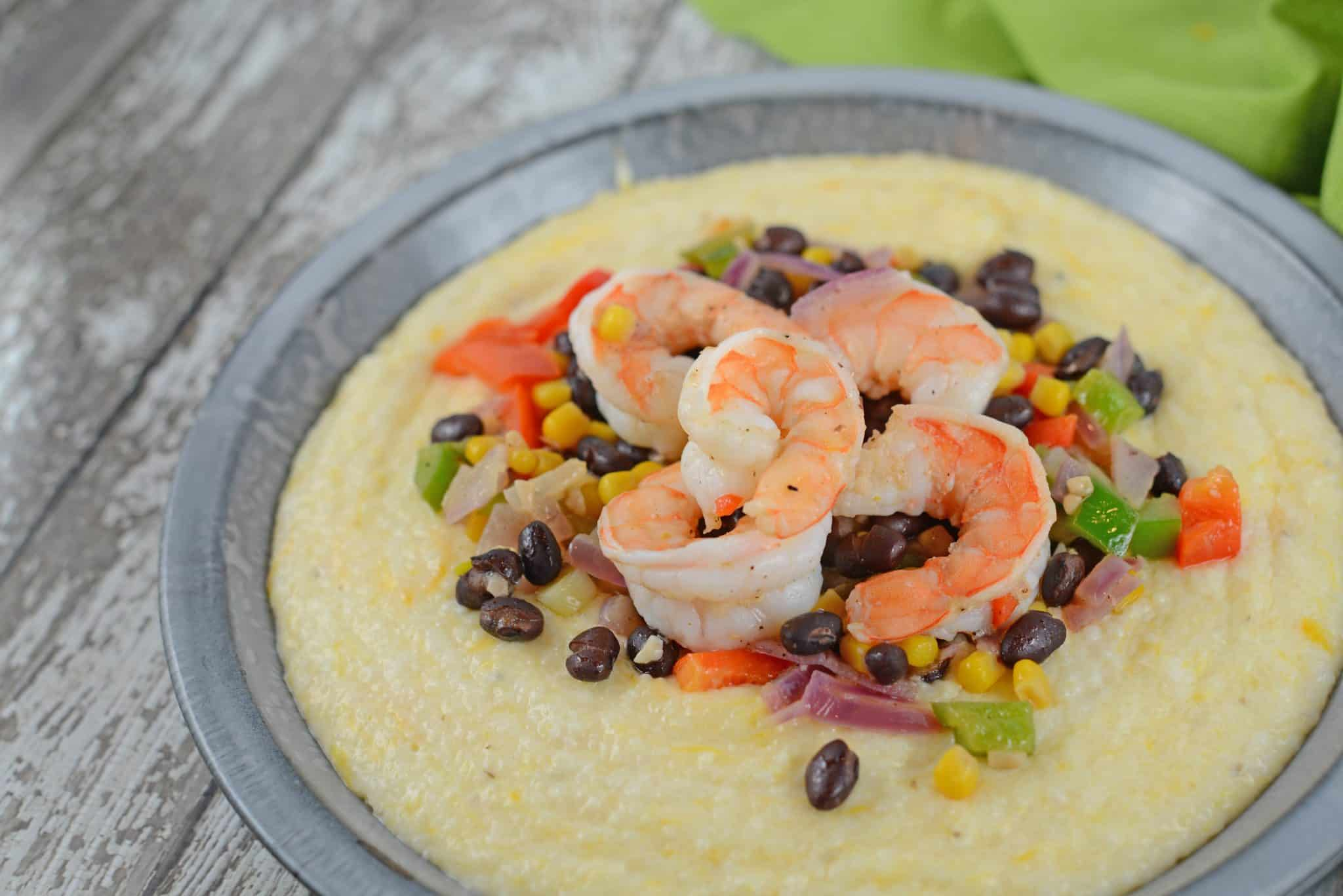 Southwestern Shrimp and Grits is a new take on an old classic combining Texas Caviar with Creamy Cheddar Grits and shrimp!
