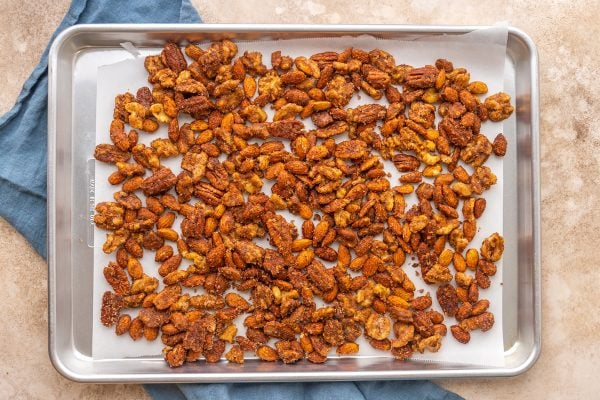 spiced nuts on a baking sheet