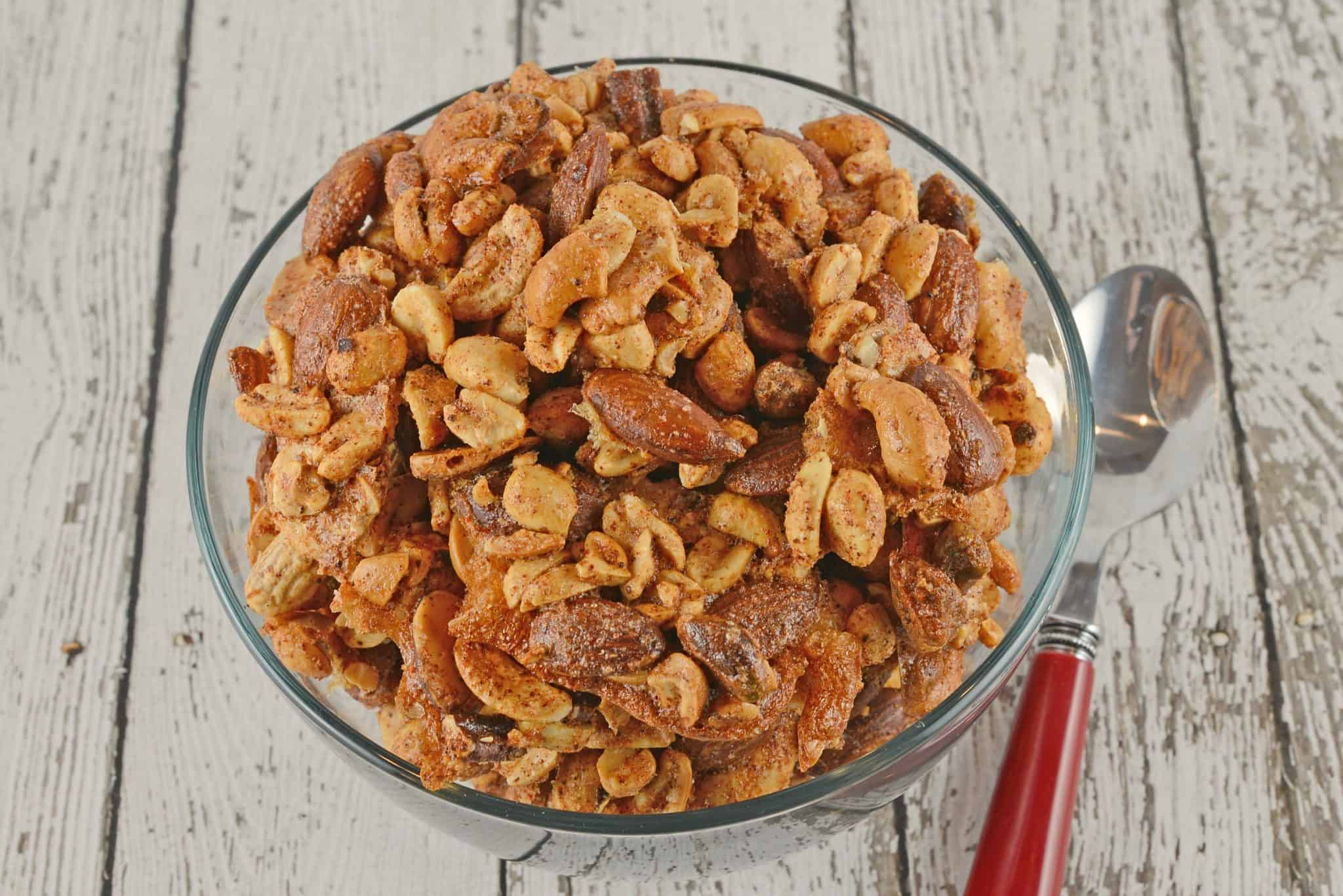 Spiced Nuts are a easy & flavorful blend of roasted nuts. Assorted with shelled peanuts, cashews, pistachios & almonds! This recipe is the perfect party snack! #snackmix #spicednutsrecipe #mixednuts www.savoryexperiments.com