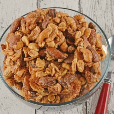 Spiced Nuts are an easy and flavorful blend of roasted nuts. Assorted with shelled peanuts, cashews, pistachios and almonds, they are the perfect munchie for any party!