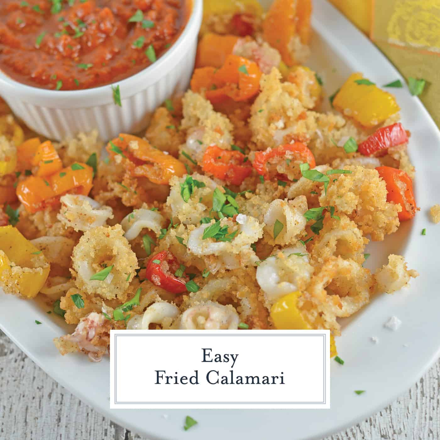 This is the best calamari recipe that you will come across, Fried Calamari are crispy squid fried to golden brown perfection. #easyfriedcalamari #calamarirecipe #calamarifritti www.savoryexperiments.com